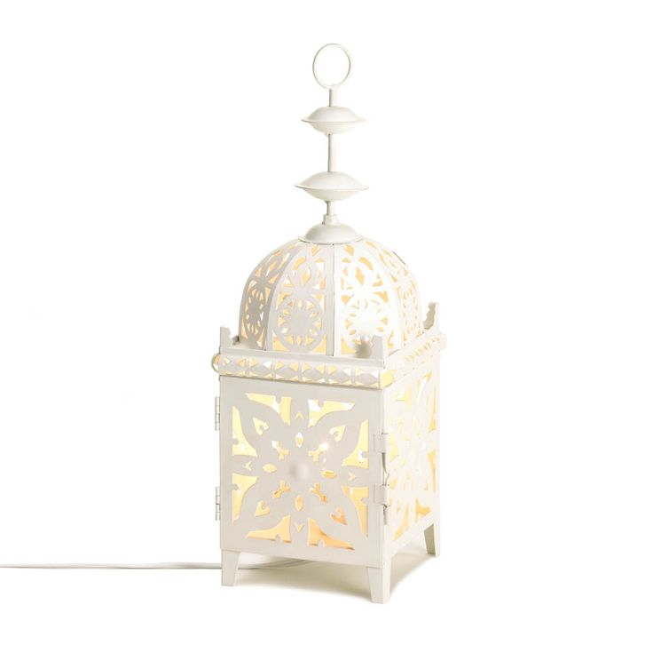 All the charm of a candle lantern, with the convenience and reliability of an electric lamp! This gorgeous table lamp features a single interior bulb that creates a spectacle of light and shadow from within this metal lantern's intricate cutout pattern.