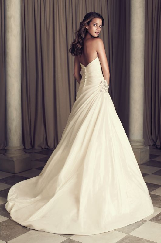 Silk Dupioni Wedding Dress. Crossover ruched bodice with full side pleated draped skirt. Side beaded flower embellishment. Covered buttons and loops over zipper. Cathedral Train. Style 4461. #PalomaBlanca #PalomaGown Paloma Blanca Wedding Gown