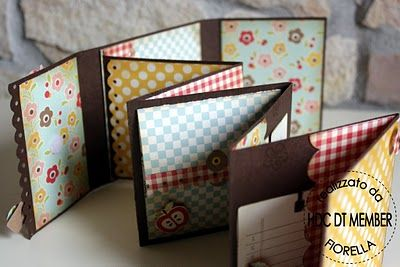 I've got to make this one!  Very cute mini album, very similar yet totally different from the ones I've made!  :o)