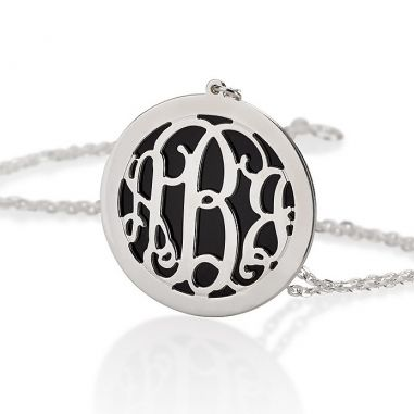 Silver monogram necklace with black background