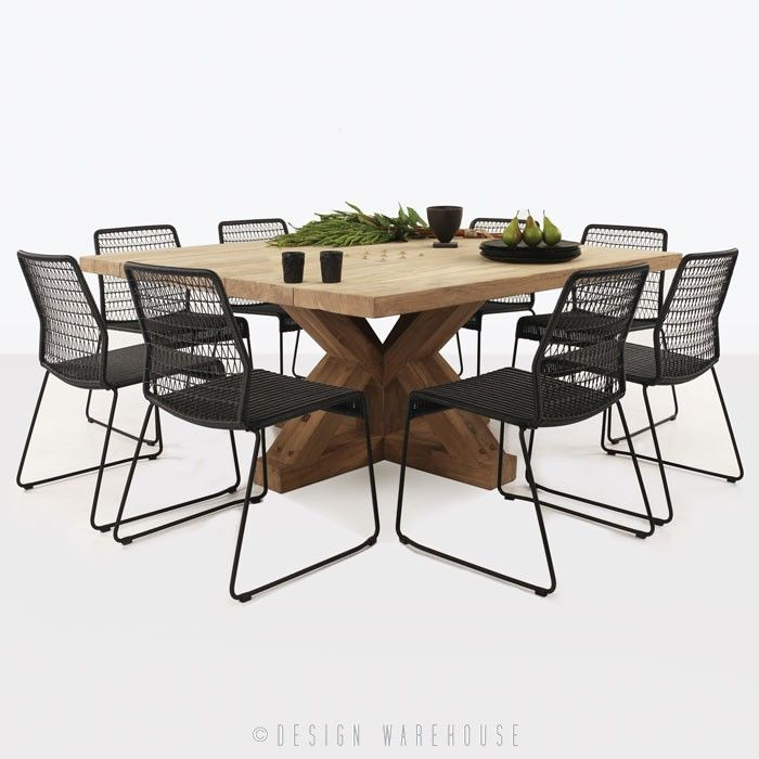 reclaimed teak dining table with eight black chairs