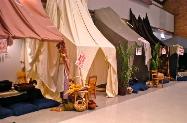 Marketplace tents, using pvc framing and then draping fabric and pinning to the wall