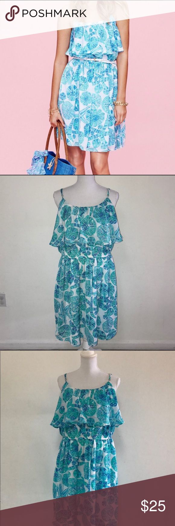 "NWT Lilly Pulitzer for Tagert Sea Urchin Dress!! *belt not inlcuded. New with tags. Ruffled Neck line. Adjustable Spaghetti Straps. Lined. Price is firm. Measurements were taken laying flat and are approx.: Bust: 20 1/2"" Waist: 17"" Hip: 21"" Length: 36"" 100% polyester Lilly Pulitzer for Target Dresses Mini"