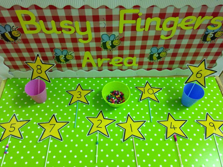 Threading the right number of beads on a fairy wand for a busy fingers activity