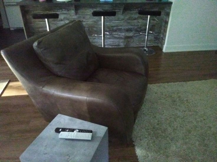 Leather chair found on local classifieds.  Cement look table from Bouclair Maison.