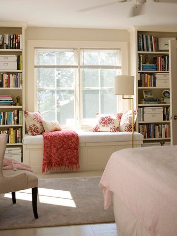 Window seat with throw and pillows...this could work in my new guest bedroom/workout room! Add an inflatible mattress for guests and voila! Store bedding in cupboards under the window bench! <3