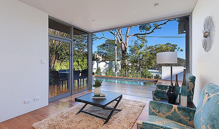 Residential architecture, Smith Residence, Castlecrag, New South Wales. This substantial family home in Castlecrag maximises the potential yield of the site as well as exposure to the surrounding water views whilst still maintaining privacy.
