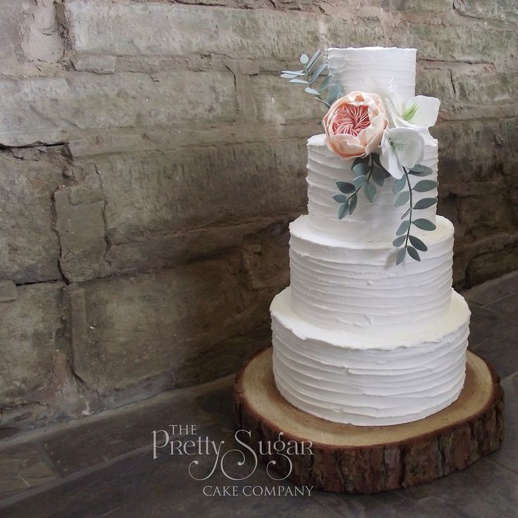 Rustic icing style wedding cake with David Austin sugar rose