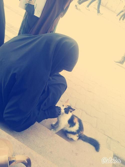 Muslimah and Furry Friend
