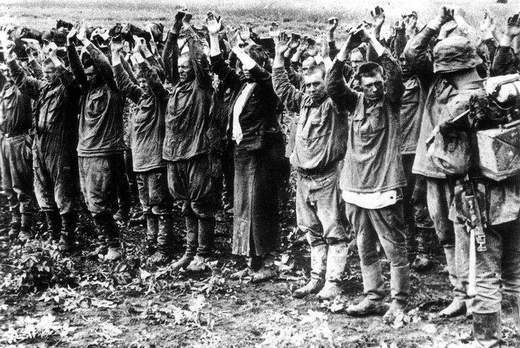German propaganda photo showing Russian POWs during the early phases of Operation Barbarossa, 1941.