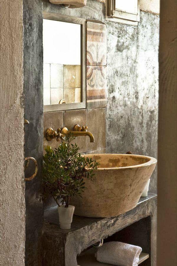 Amazing earthy stone bathroom.