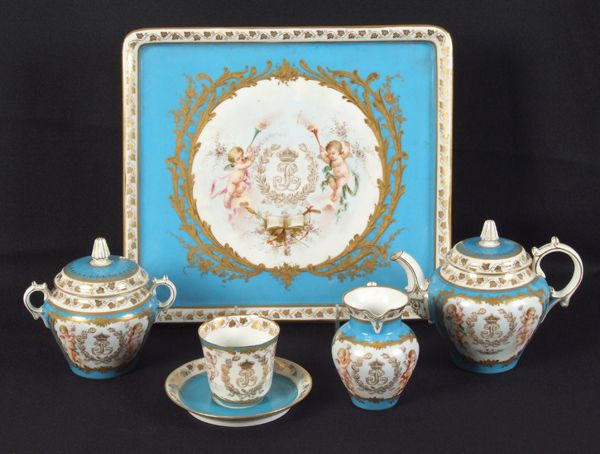 19th c. 5 piece Sevres porcelain tea set from the Louis Philippe period, all with blue borders gilt monogram for Louis Philippe, putti, ribbon swag and floral decoration.  Marked: Blue circle Louis Philippe initials, red circle with Crown Chateau des Tuileries, green double cipher of Louis Philippe (1845-1848).
