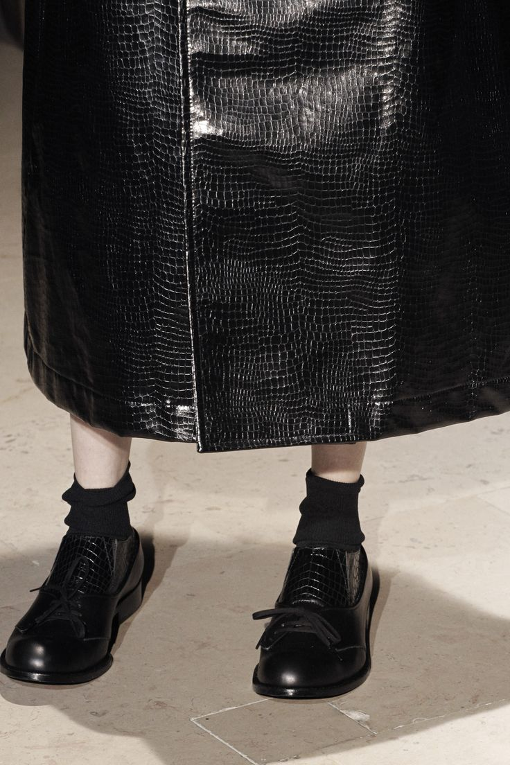 Comme des Garcons AW2011-Fibber. This is a kid changing in the dressing room- that has leather look curtains.