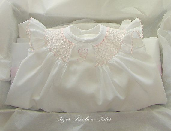 Sweet angel sleeve bishop with monogram.  The unsmocked portion does look a bit gathered.