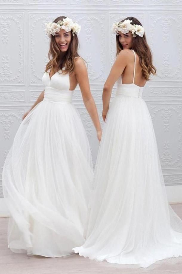 Long wedding dress with V-neck and applications