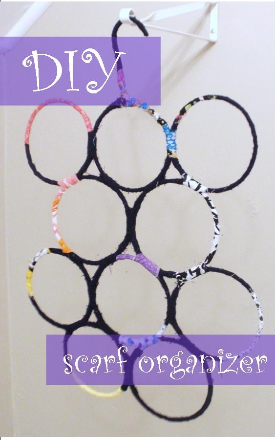 diy scarf organizer.  wire hangers, tape, string.  i can do this.