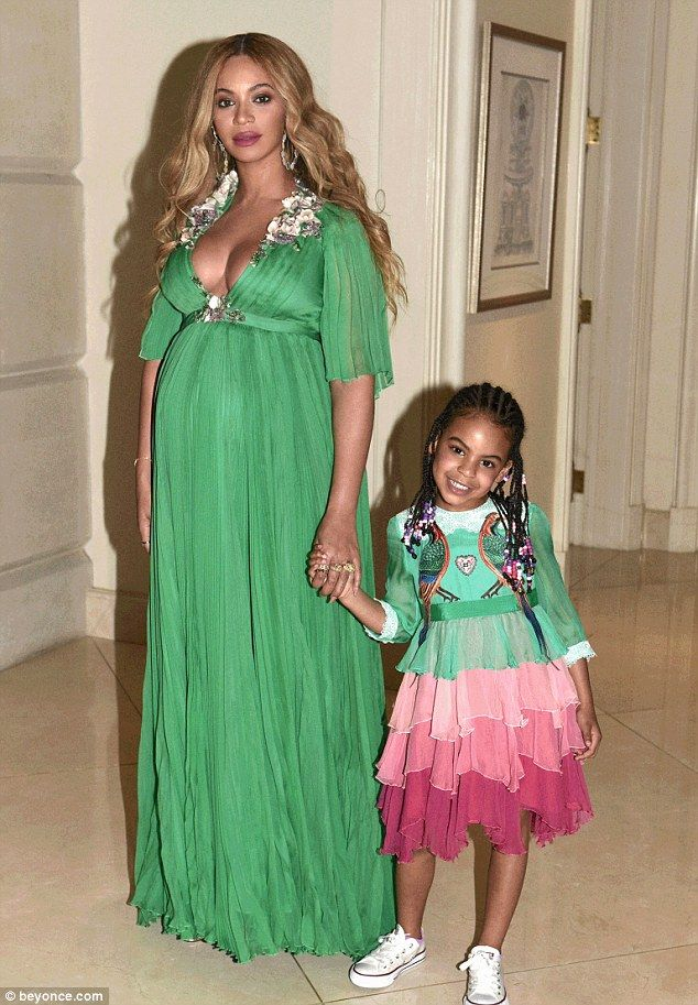 Mom and daughter: Blue Ivy matched mom in a ruffled dress with green top and pink skirt