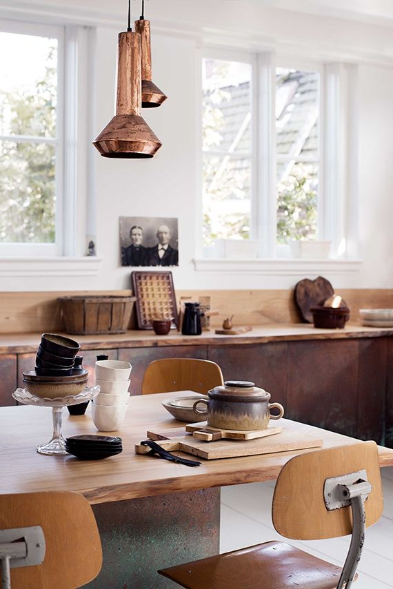 Warm metals, ceramics and unrefined woods in this kitchen