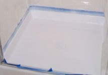 Can't afford a new shower pan? Refinish it! Painted Fiberglass Shower Pan Tutorial.
