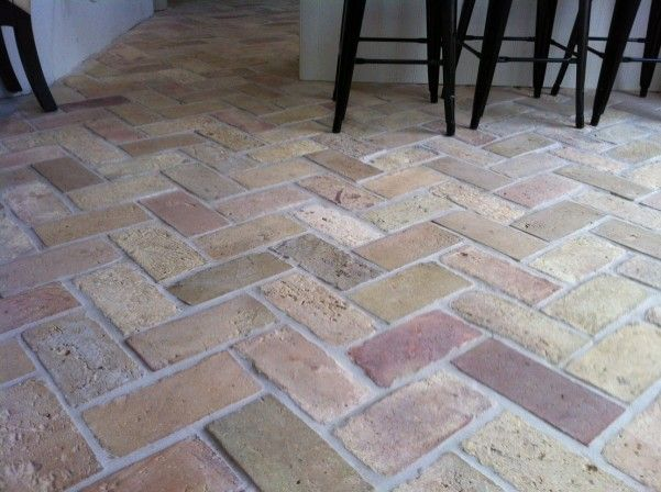 Reclaimed Flooring. The beauty of the variation in the tones & textures within a reclaimed brick tile floor.
