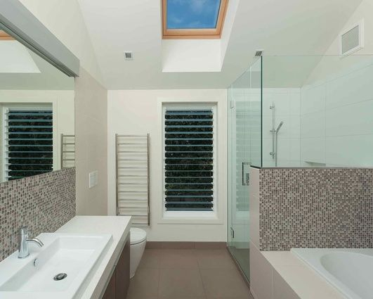 A high level of privacy for this family bathroom meant a large louvred window was able to be installed.
