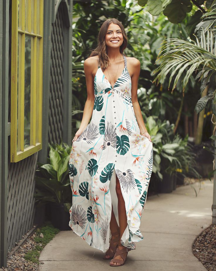 Bohme absolutely loves our Tropical Thunder Maxi, it screams tropical vacation! This piece features a beautiful floral leaf pattern, v-neckline, thin straps, a side zipper, front button down and front slit.