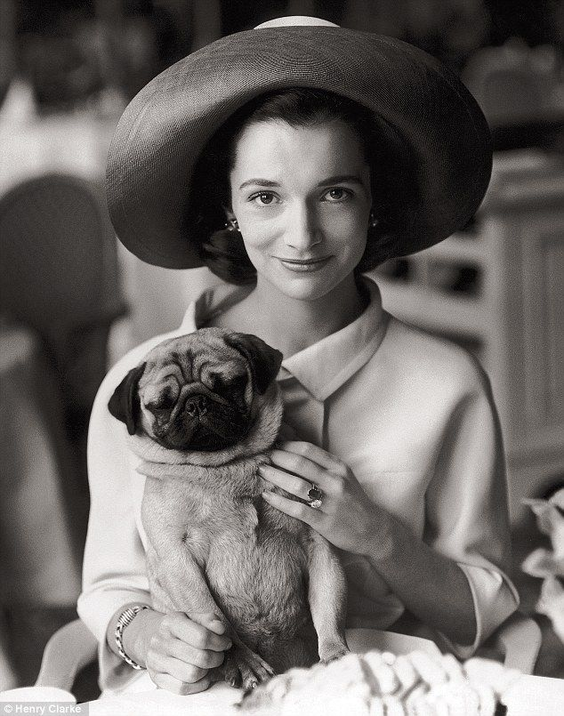 Lee Radziwill, younger sister of Jacqueline Kennedy, snapped by Henry Clarke in August 1960 with her pug Thomas, who used to accompany her to tea at the Ritz.