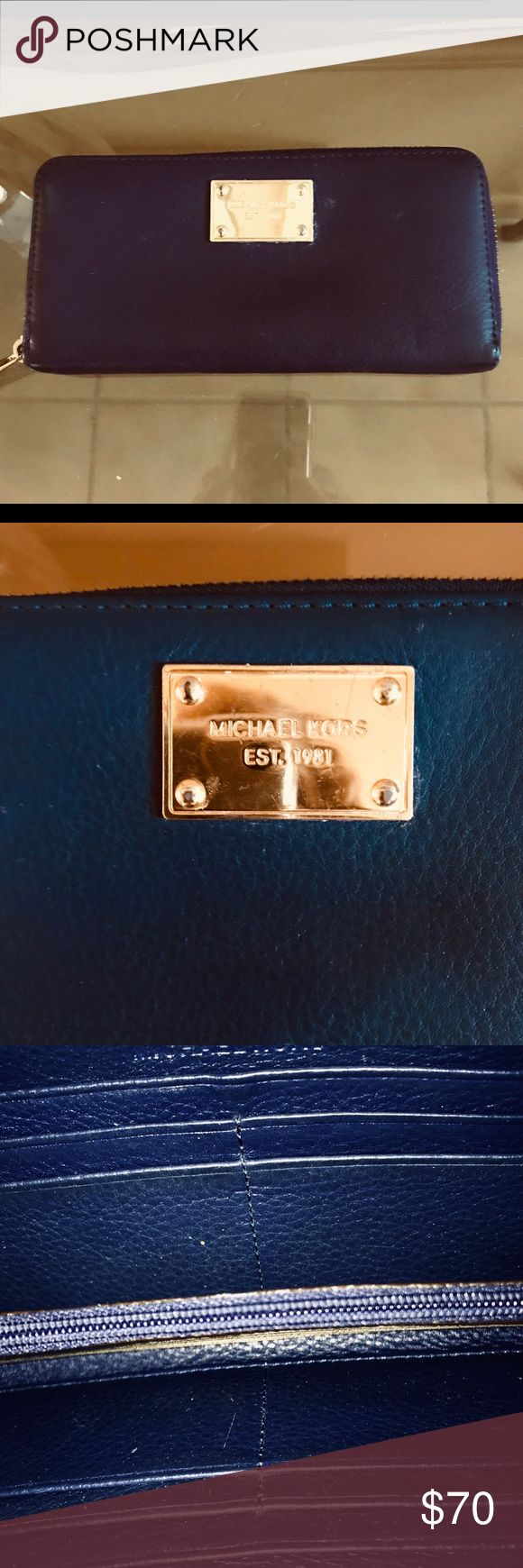 """🔴MICHAEL KORS CONTINENTAL WALLET 🔴THIS IS A BEAUTIFUL DARK NAVY WITH ROYAL BLUE UNDERTONES MICHAEL KORS AND GOLD TONE HARDWARE CONTINENTAL WALLET.  TWELVE SLOT COMPARTMENTS FOR CREDIT CARDS. ZIPPERED INTERIOR POCKET. TWO GUSSETS FOR BILLS.  WALLETS ZIPS CLOSED FOR SECURITY. LEATHER IS CONDITIONED AND IS EXCELLENT WITHOUT SIGNS OF WEAR. INTERIOR IS CLEAN AND IN EXCELLENT CONDITION. APPROXIMATELY 8"""" L x 4"""" W. OPENS APP. 5"""". THERE IS SOME MINOR SCRATCHING ON HARDWARE. PLEASE LOOK AT LAST TWO…"""