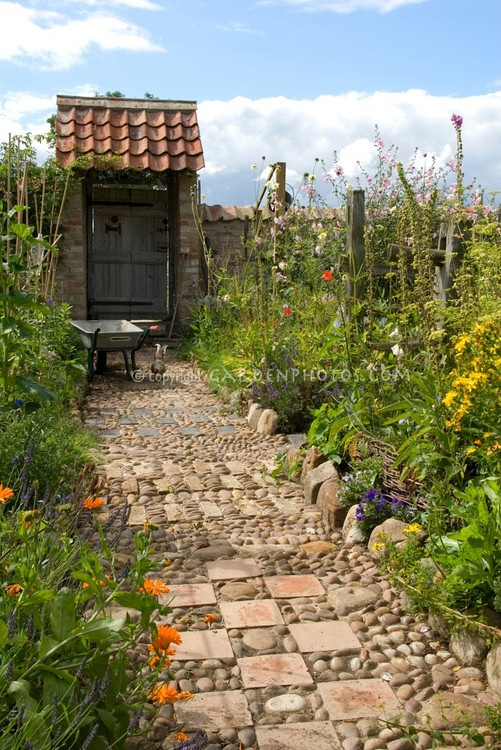 path of stones, pebbles & tiles: Gardens Ideas, Blue Sky, Gardens Paths, Garden Paths, Gardens Gates, Flower Gardens, Pebble Tile, Flowers Gardens Border, Stones