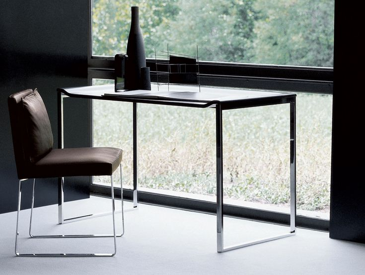 Vague Italian designer console handmade and shown in ebony. This contemporary Italian furniture collection features a wide selection of finishes including American walnut, white ash, natural oak, lati wenge, and various matt lacquered colors.Console structure available in polished chrome, metallised epoxy and matt epoxy. Samples available upon request. Made in Italy.