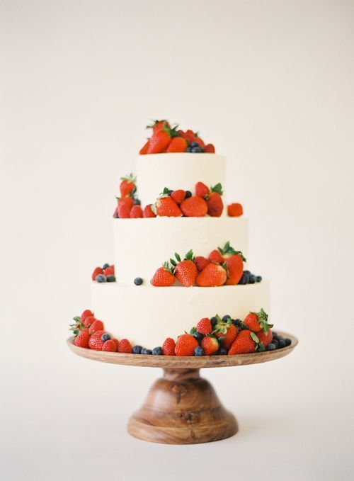 piles of strawberries on a wedding cake