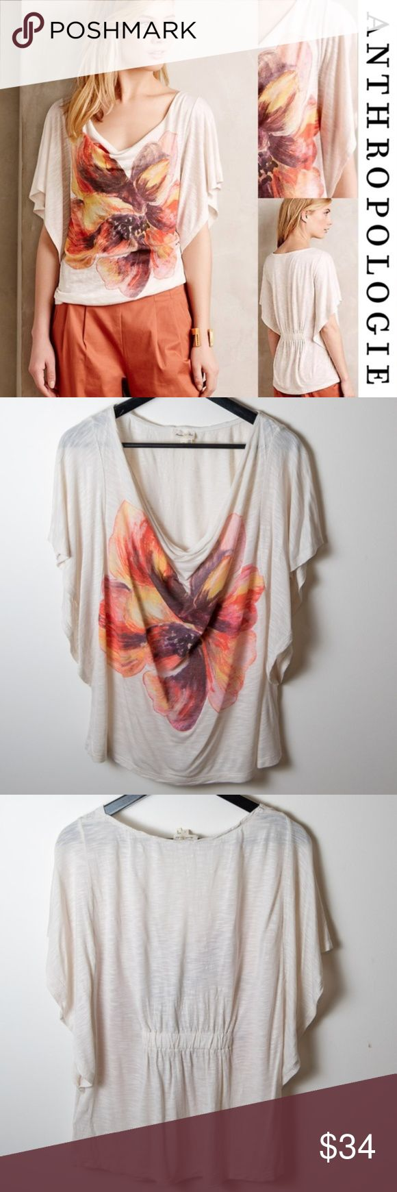 Anthropologie Meadow Rue Floriated Cowlneck Tee Anthropologie Meadow Rue Floriated Cowlneck Tee in medium. Batwing sleeves, cinched back, pull on style. With large flower on front of teeshirt. Rayon jersey. Hand wash. Good preloved condition. No noticeable holes or stains. Does have some pulling at the top of shoulder, see photo. Fluttery sleeves, soft cowlick, large graphic print. The longest part of the flutter sleeves connects to the body of the shirt right at the waist. Off white blouse…