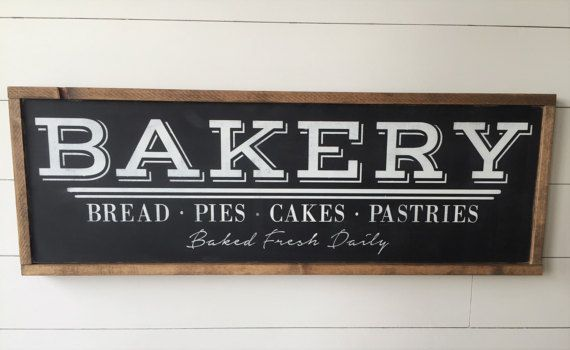 Give your Kitchen or Dining room that fixer-upper farmhouse feel with this vintage inspired Bakery Framed Wood Sign.  12x36 and will be customized when you choose your own colors. Hand painted and distressed to have a true vintage feel. Pictured sign is shown with BLACK BACKGROUND, WHITE LETTERING, and WALNUT FRAME. This item is handmade right on the farm here in Idaho. Full of that farmhouse chic, Fixer-Upper style that were all craving. Customize your wood sign with your choice of frame…