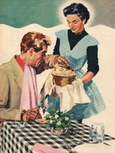 Woman in Apron Serving Husband
