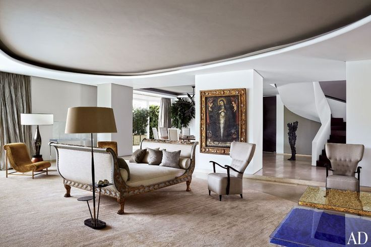 An Empire daybed anchors the living area of handbag designer Nancy Gonzalez's glittering apartment in Colombia