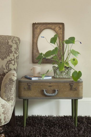Love this ~ another use for a vintage suitcase.  The bathroom organizer on this site is precious too.