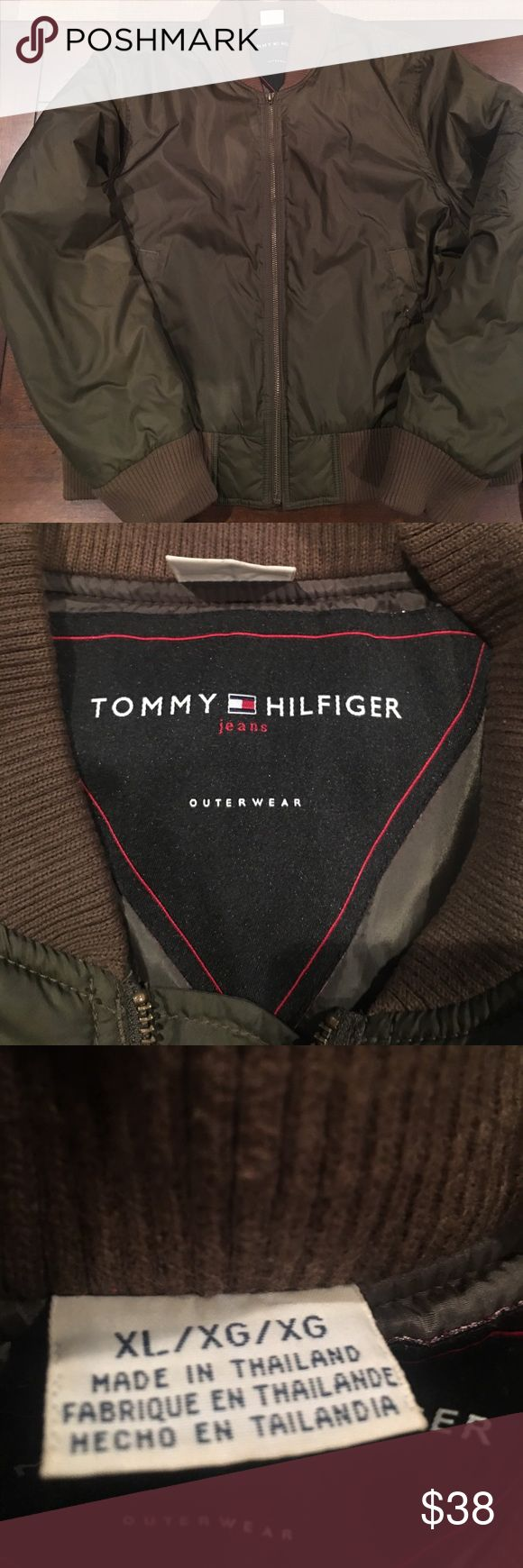 Tommy Hilfiger bomber jacket Tommy Hilfiger olive green bomber jacket. Only flaw is the zipper tag is missing, otherwise excellent condition. Tommy Hilfiger Jackets & Coats Puffers