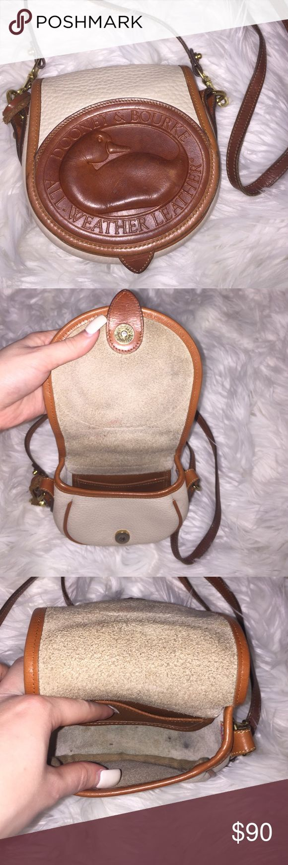 Dooney & Bourke All Weather Leather Side Purse Super cute and has lasted me forever! It's a collectors! Dooney & Bourke Bags Crossbody Bags
