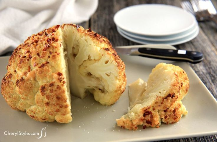This whole roasted cauliflower is the perfect appetizer or side dish to set out for your guests at the dinner table. they can cut out a slice and chow down! - CherylStyle