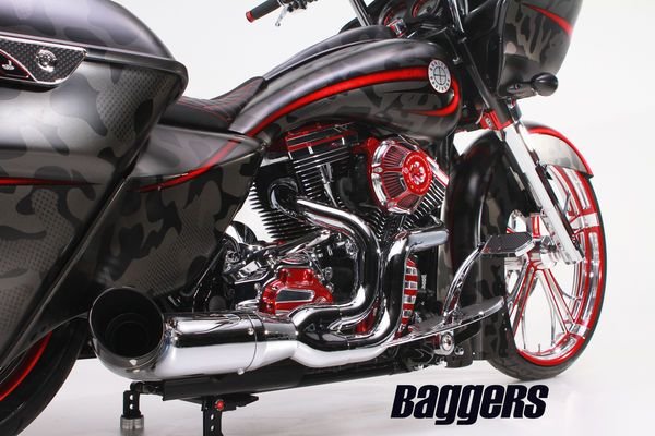 Former Navy Seal Chris Kyle, and his autobiography-turned-blockbuster-movie American Sniper has quickly gained mass attention since the movie was released. The Bike Exchange and one of its long-time customers, Allen Burchell, wanted to show respect to American Heroes by building their own rendition of a patriotic hero in honor of US Military vets with this custom 2015 Harley-Davidson Road Glide.