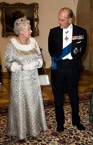 The Queen and The Duke of Edinburgh arrive for a State Banquet at Brdo Castle in Ljubljana during a State Visit to Slovenia in October 2008.  Her Majesty is wearing a dress made for the occasion from silver-grey brocade fabric given to her during a tour of the Middle East in the 1980s.© Press Association