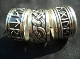 Google Image Result for http://www.thevikingstore.co.uk/ekmps/shops/thevikingstore1/images/viking-jelling-dragon-ring-%5B3%5D-737-p.jpg