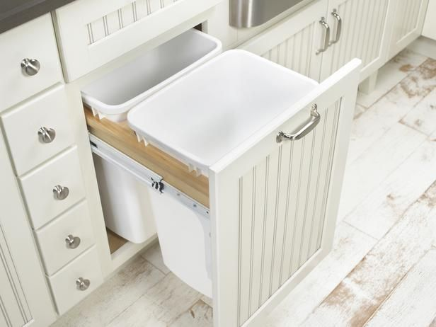 Pullout cabinets can house several bins for recycling glass, plastic, periodicals and waste.