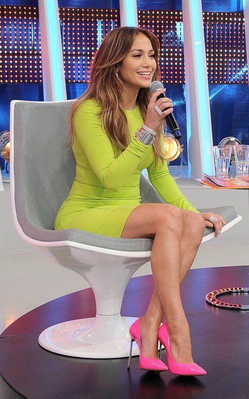 Jennifer Lopez's Sao Paolo Brazil Michael Kors Neon Yellow Crewneck Dress, Hermès Collier de Chien Silver Bracelet, and Pop Pink Casadei Patent Point-Toe Blade Pumps