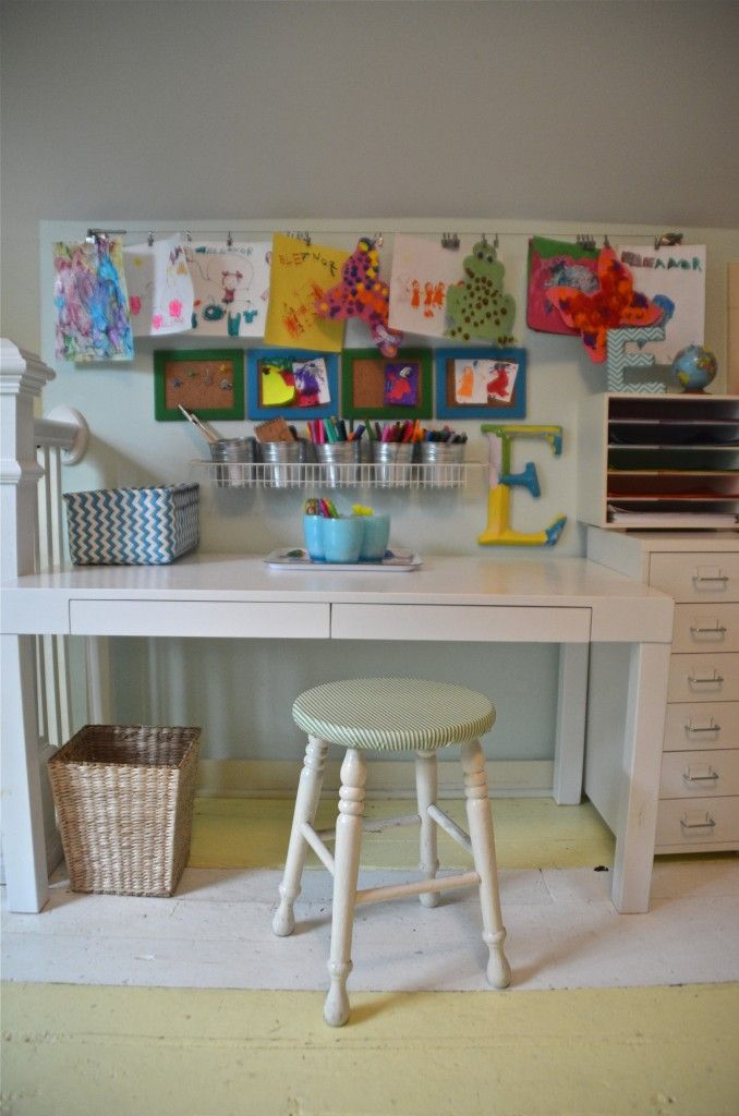 Colorful and functional child's art space with a few simple storage solutions and plenty of display space!