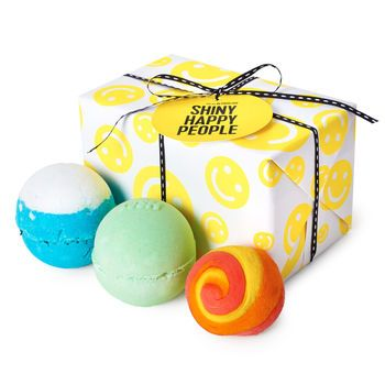 Shiny Happy People. Wrapped Gift. $23 by Lush Want to make someone smile today? Start here. Our Shiny Happy People Gift is filled with goodies that will have anyone grinning from ear to ear. Avobath Bath Bomb is a lemongrass fizzer that was made to brighten moods, while Big Blue Bath Bomb's lavender and lemon oil blend help clear and soothe the mind. And for a sunnier disposition, just add Brightside: the bubble bar that will make water soft (and orange) and with a cheerful citrus scent.