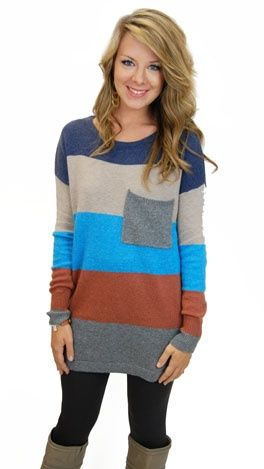 A sweater dress with autumn colors/stripes