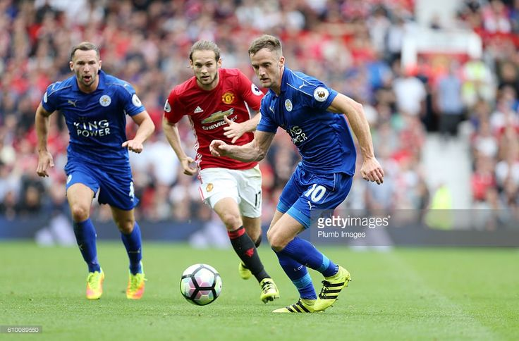 Andy King of Leicester City in action with Daley Blind of Manchester United during the Premier League match between Manchester United and Leicester City at Old Trafford on September 24th, 2016 in Manchester, United Kingdom.