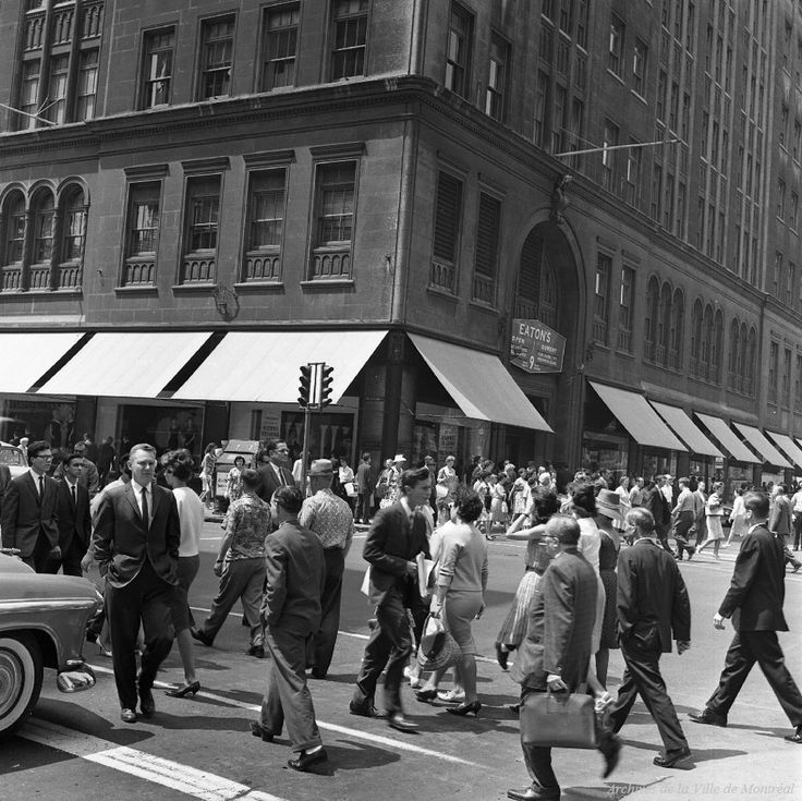 "The northwest corner of Montreal's Ste-Catherine Street, seen here at University Avenue in 1961. Tourists have remarked fondly about the ""functional chaos"" as pedestrians and automobiles compete for space."