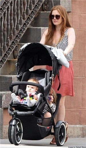 Isla Fisher spotted out with a Phil & Ted Explorer  http://www.cherishme.ie/philandtedsbuggy.html